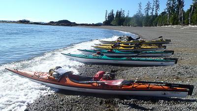 Kayaking Haida Gwaii - Kayaks on beach in Gwaii Haanas National Park