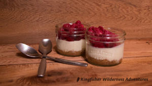 Cheesecake topped with raspberries for dessert.