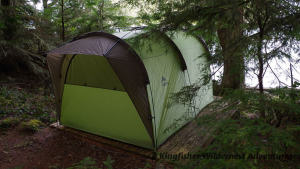 The base camp tents are situated on wooden platforms throughout the forest with views of the ocean.